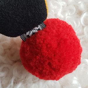 Produktbild: En röd pompom boll
